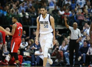 Mar 20, 2016; Dallas, TX, USA; Dallas Mavericks center Salah Mejri (50) yells as he reacts to a dunk in the fourth quarter against the Portland Trail Blazers at American Airlines Center. The Mavs beat the Trail Blazers 132-120 in overtime. Mandatory Credit: Matthew Emmons-USA TODAY Sports